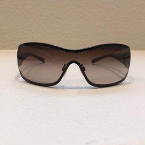 0325fe98a9 CHANEL · Chanel Metallic Brown Camellia Shield Sunglasses